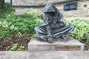 Statue in front of a church in Ottawa